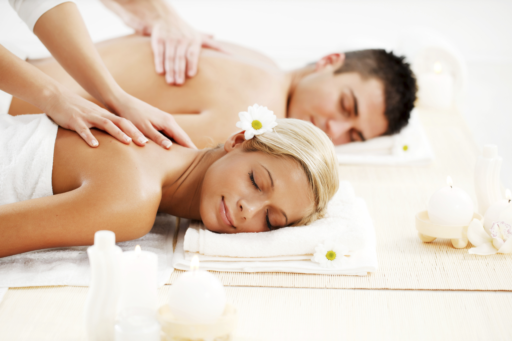 Romantic couple is having a back massage in spa center.